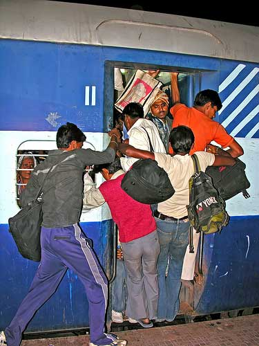 A crowded train in India via http://www.flickr.com/photos/archer10/