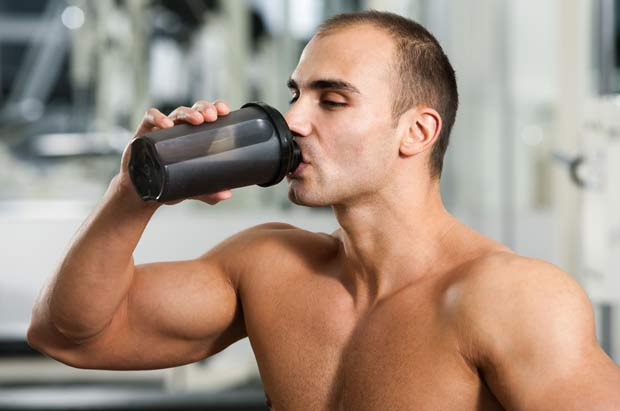 Guy drinking protein shake after workout