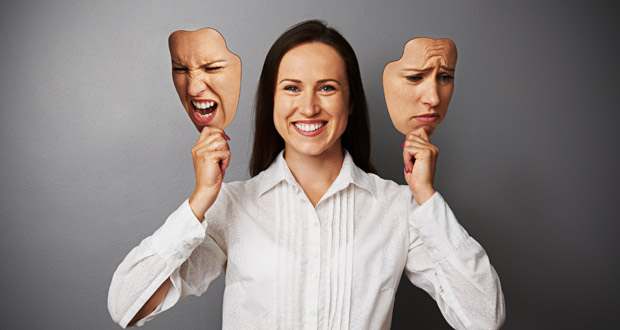 Woman with masks to represent multiple personalities
