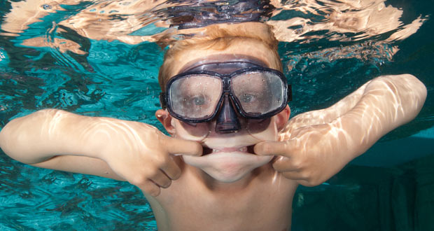 Boy posing for underwater photo