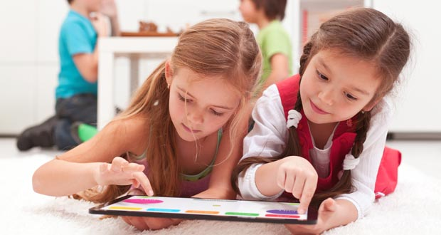 Two girls learning on a kids website